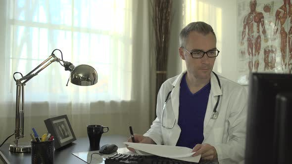 Thumbnail for Doctor Working At His Office Desk 20