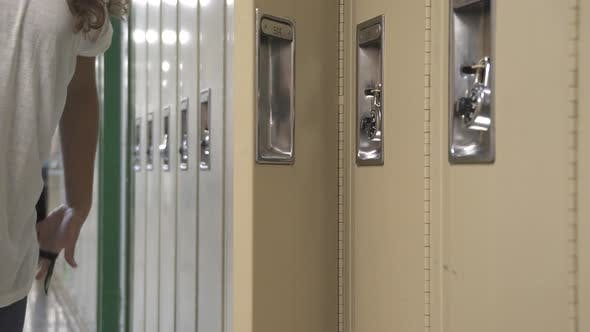 Thumbnail for Student Using Her Locker (1 Of 2)