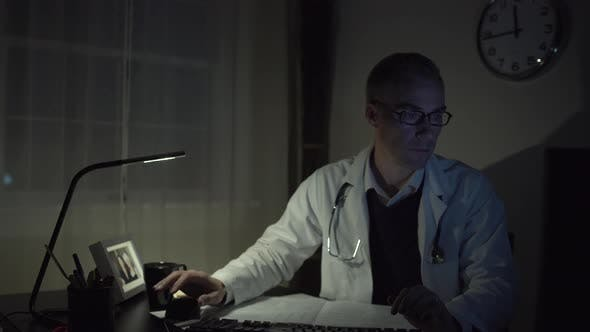 Thumbnail for Doctor Working At His Office Desk 3
