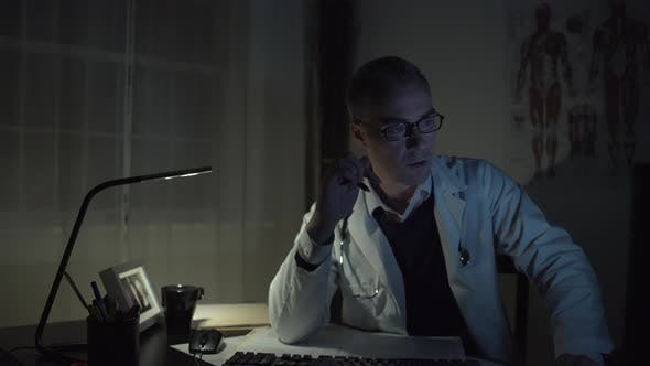 Thumbnail for Doctor Working At His Office Desk 5