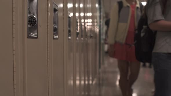 Thumbnail for Students Walking Down Hall By Lockers (3 Of 16)