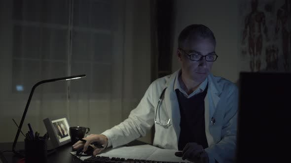 Thumbnail for Doctor Working At His Office Desk 6
