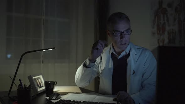 Thumbnail for Doctor Working At His Office Desk 7