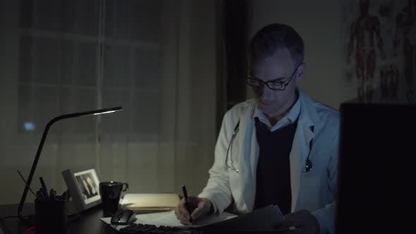 Cover Image for Doctor Working At His Office Desk 8