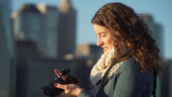 Thumbnail for A Woman With Camera 1
