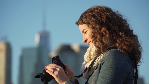 Thumbnail for A Woman With Camera 2