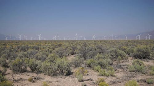Pan Up Of A Windfarm In The Desert