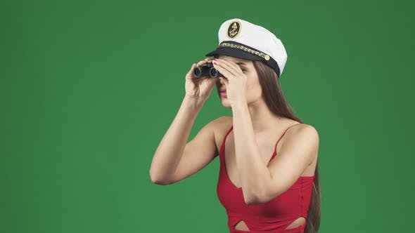 Thumbnail for Stunning Woman in a Sailor Cap Smiling After Looking Away Through Binoculars
