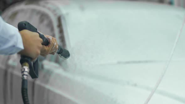 Thumbnail for Hands of Male Holding Sprayer, Covering Expensive Auto with Foam, Car Washing