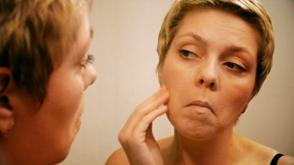 Thumbnail for Woman Applies Make-up Concealer Foundation Cream
