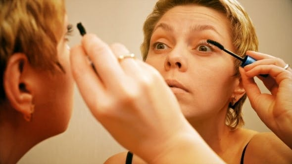 Thumbnail for Pretty Blond Woman Applying Mascara Make-up