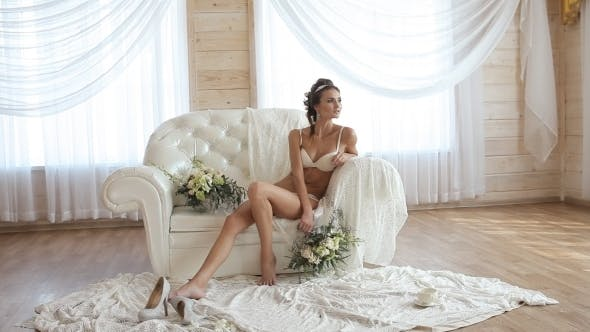 Thumbnail for Sexy Model In White Lingerie Sitting On a White Sofa