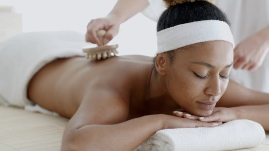 Thumbnail for African Woman Receiving Back Massage