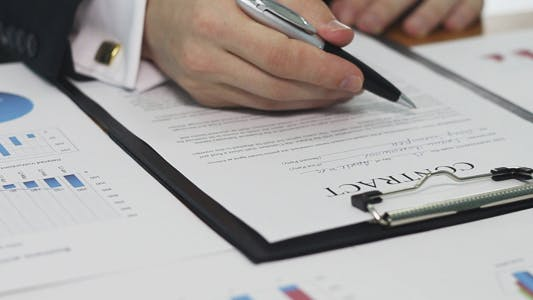 Thumbnail for Businessman Carefully Reads and Signs the Contract