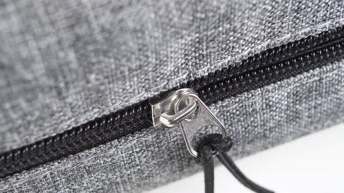 Zip lock on a gray backpack
