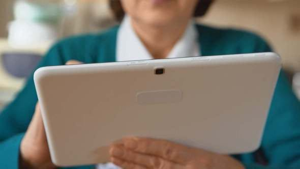 Thumbnail for A Tablet PC In An Adult Woman Hands