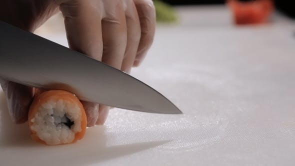 Thumbnail for Cooking Sushi Rolls In The Studio. Cutting Into Portions, a Round Roll
