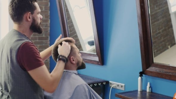 Thumbnail for Friendly Bearded Man Barber Makes Hairstyle