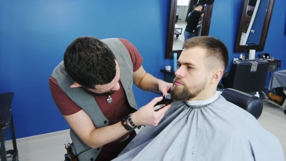 Thumbnail for The Bearded Barber At Work