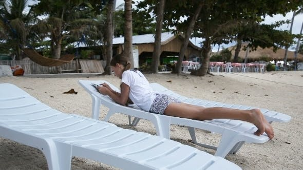 Thumbnail for Young Girl With Tablet Pc At The Beach.