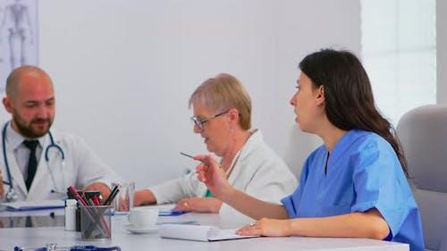 Team of Doctors Having Medical Conference Dividing Their Tasks