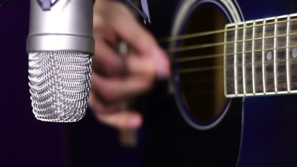 Thumbnail for Playing Acoustic Guitar In Studio