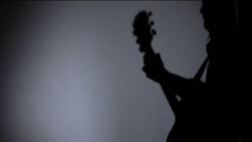 Silhouette des Musikers