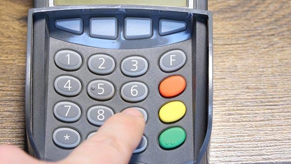 Thumbnail for Hand Dials The Pin Code Into Credit Card Reader