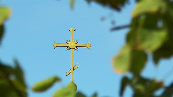 Thumbnail for The Cross on the Dome Among Leaves