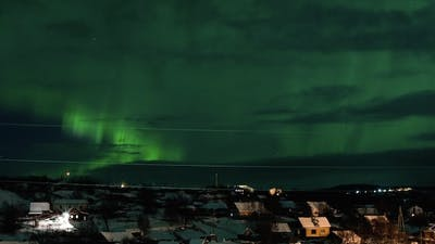 Northern Lights Above Houses