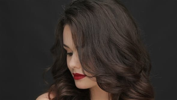 Thumbnail for Attractive Girl Straightens Her Hair