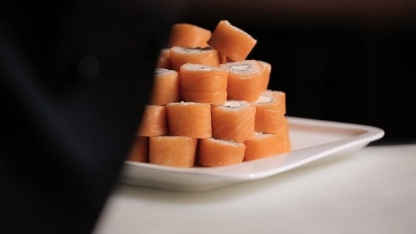 Thumbnail for Unfolding Sushi Rolls Philadelphia Pyramid On a Plate.