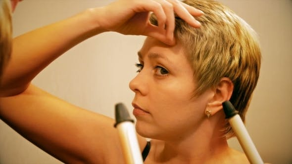 Thumbnail for Short Hair Woman Curls Her Hair With Curling Iron