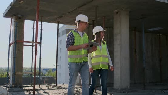 Thumbnail for Supervisor of a Building Under Construction Man Discussing with Engineer Designer Woman the Progress