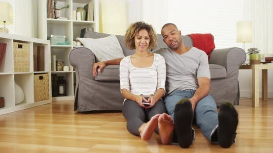 Thumbnail for Cute black couple playing with their feet