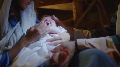 Crop Mary and Joseph Caressing Baby Jesus