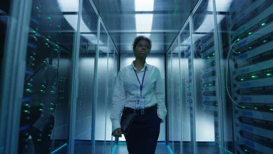 Thumbnail for Woman Walking Among Server Racks