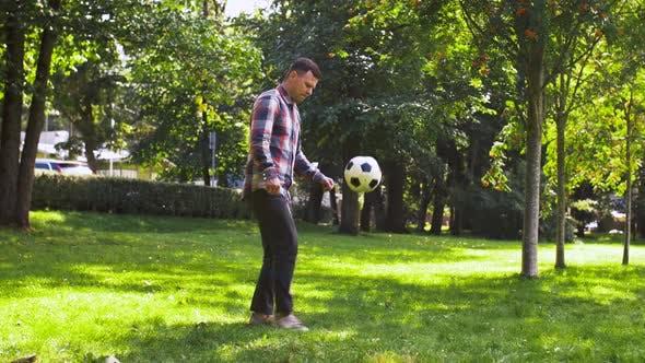 Thumbnail for Man Playing with Football at Summer Park