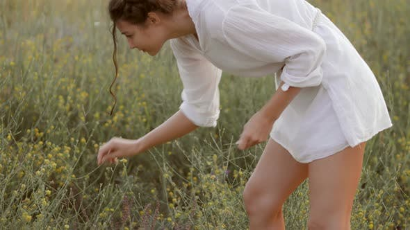 Thumbnail for Natural Beauty Girl Gathering Flowers Outdoor in Freedom Enjoyment Concept.