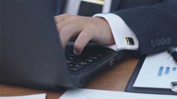 Thumbnail for Businessman Working on a Laptop in the Office