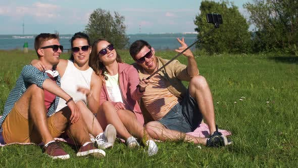 Thumbnail for Friends Taking Picture By Selfie Stick in Summer