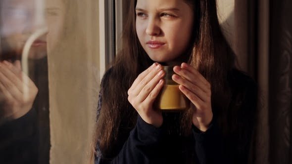 Cover Image for Little Girl At The Window With a Cup Of Coffee