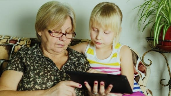 Thumbnail for Girl And Grandmother Use Tablet