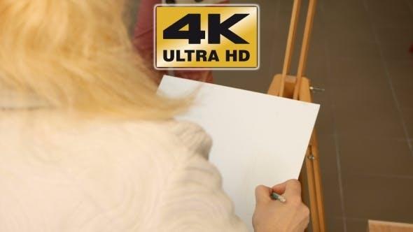 Thumbnail for Female Artist Draws a Pencil Sketch In Art Studio