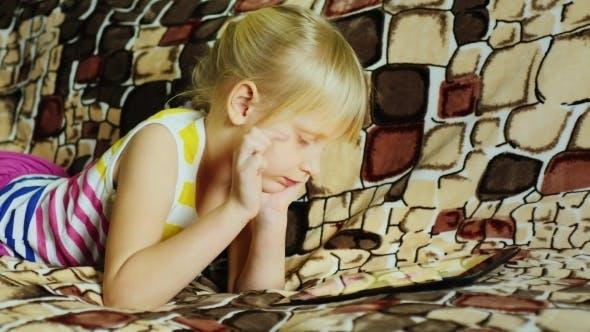 Cover Image for Blonde Girl Enjoys The Tablet