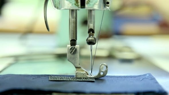 Thumbnail for Woman Sews Clothes In a Sewing Workshop