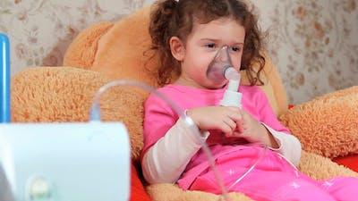 Child Breathes Into The Inhaler