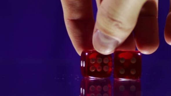 Thumbnail for Playing Red Casino Dice Cubes On a Glass Table.