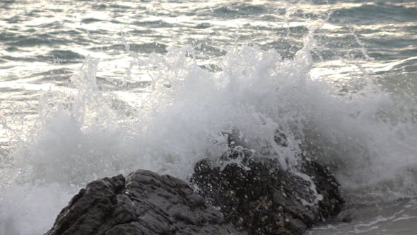 Sea Waves Splashing On Rock