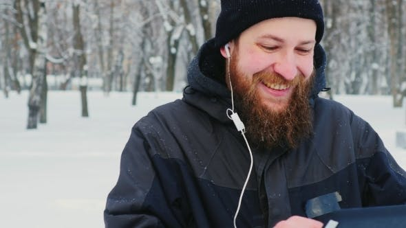 Thumbnail for Attractive Bearded Man Uses Tablet In Winter Park